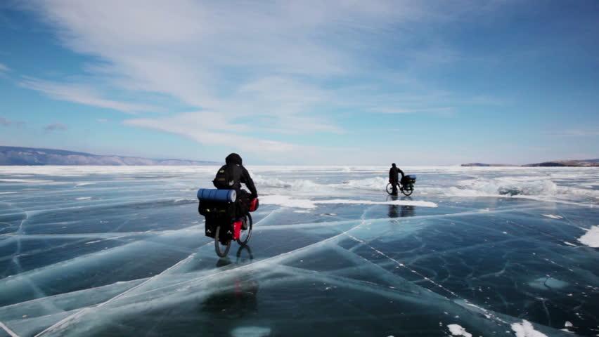 People travel on frozen Lake Baikal  Extreme winter journey across the ice deep reservoir | Shutterstock HD Video #11227166