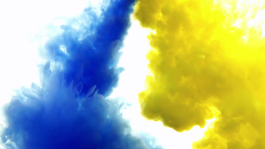 red and yellow ink in watercreative slow motion on a