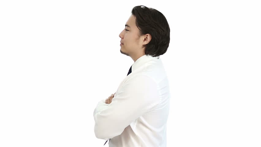 Attractive businessman in his 20s, wearing a white shirt and a blue tie. Feeling confident with his arms crossed. White background. | Shutterstock HD Video #11234576