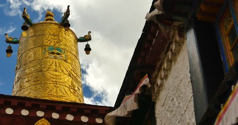 4k closeup of The Jokhang Temple In Lhasa,Tibet,white clouds in blue sky. gh2_09676_4k