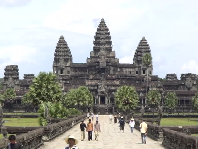 2 shots of Angkor Wat from directly in front with tourists.