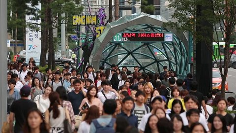 SEOUL, SOUTH KOREA - CIRCA August 2015 - Crowds of pedestrians enter and exit Gangnam Station in Seoul, South Korea.