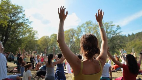 Russia, Samara, July 27, 2015: People meditating in nature at the festival ''Protoka''. Practice of meditation.