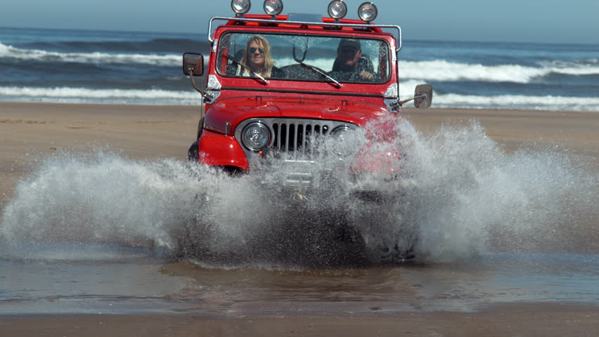 4x4 off road vehicle driving through water in slow motion, shot on Phantom Flex 4K