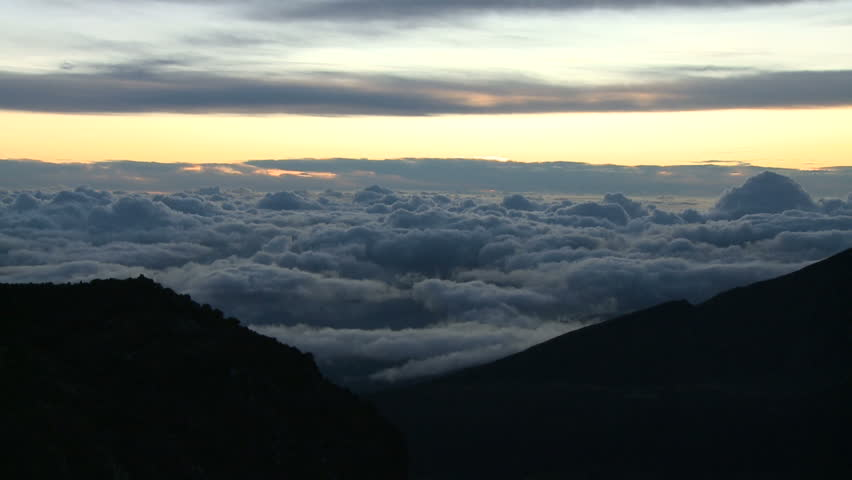 Mount haleakala hawaii above the clouds stock footage video 2162249 beautiful rising sun over clouds timelapse hd stock video clip publicscrutiny Image collections