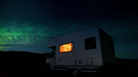 Camper van RV motor home in winter iceland northern lights night sky view travel destination adventure off the beaten track for a once in a lifetime experience - 4k time lapse timelapse