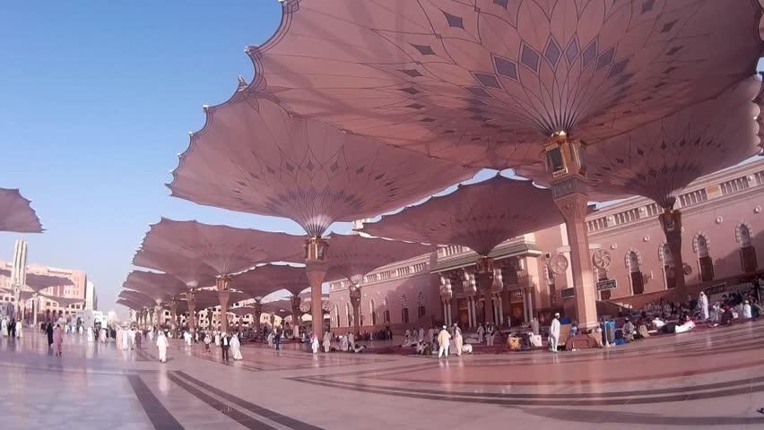 MEDINA, SAUDI ARABIA   MARCH 06, 2015: Pilgrims Walk Underneath Giant  Umbrellas Compound