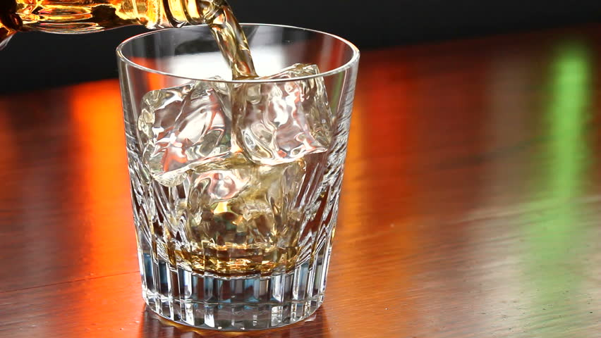 Pouring a scotch whiskey on the rocks