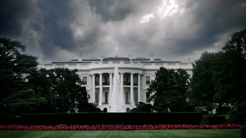 Storm clouds looming over the White House in Washington, D.C. signifying upcoming trouble. Impeachment, perhaps?