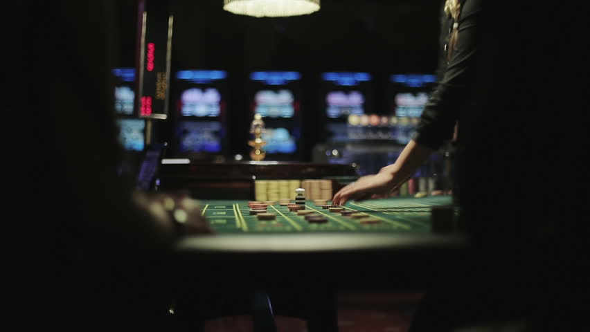 People placing bets for roulette in casino, winnings close up