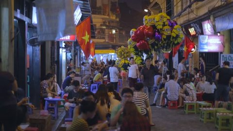 HANOI,VIETNAM - CIRCA August 2015 :people drinking beer outdoors - Ta Hien old quarter