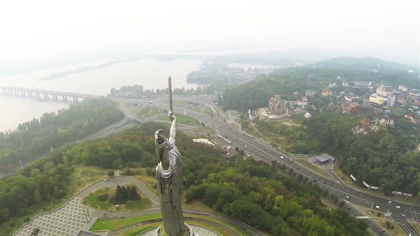 Kiev city,  Ukraine.  Over Motherland  Monument  of Soviet time. Aerial in foggy day