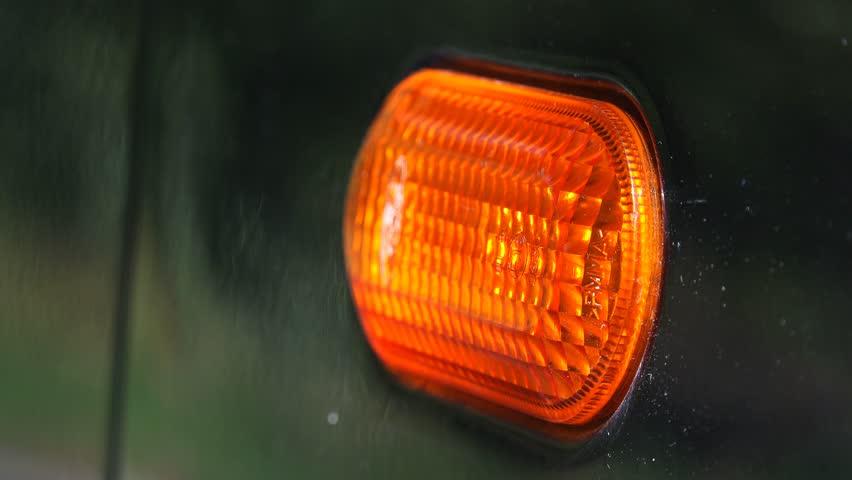 Turn Signal Light Blinking On Black Car Macro Shot Stock Footage - Car signal light
