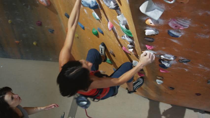 Woman climbing on an indoor climbing wall   Shutterstock HD Video #11587583