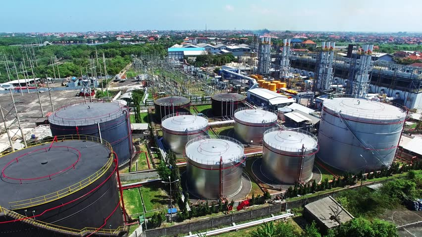 Flights above oil plant in Indonesia. View on oil tanks from top. Was using 4K drone camera