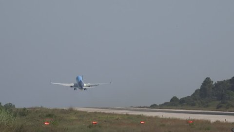 SKIATHOS ISLAND - GREECE, 5 AUGUST, 2015, 4K Commercial jetliner take off by day
