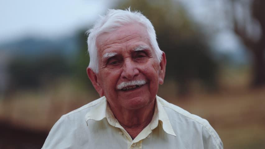 Smiling elderly man looking at camera | Shutterstock HD Video #11652386