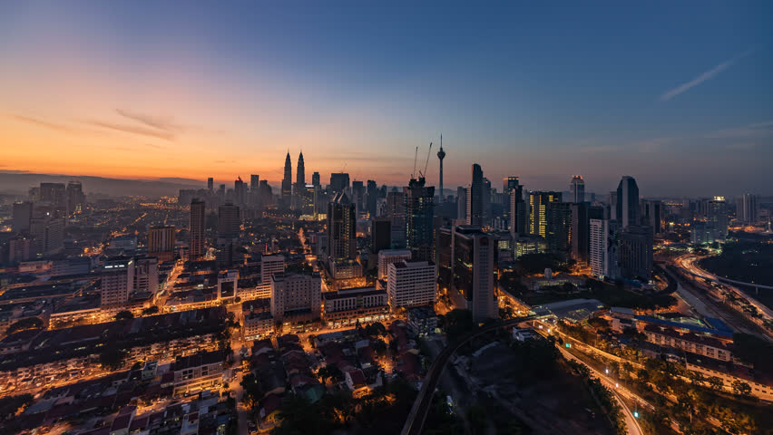 Time lapse: Kuala Lumpur city view during dawn overlooking the city skyline. Slide Effect