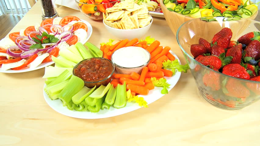 Table laid with delicious fresh fruit & vegetables as part of a healthy lifestyle diet