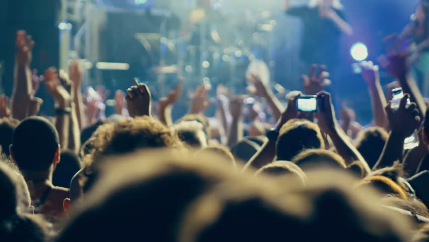 4K big crowd at concert cheering clapping hands.4k real time clip at a night rock concert showing people having fun lifting hands up in the air and applauding the musicians. | Shutterstock HD Video #11676776
