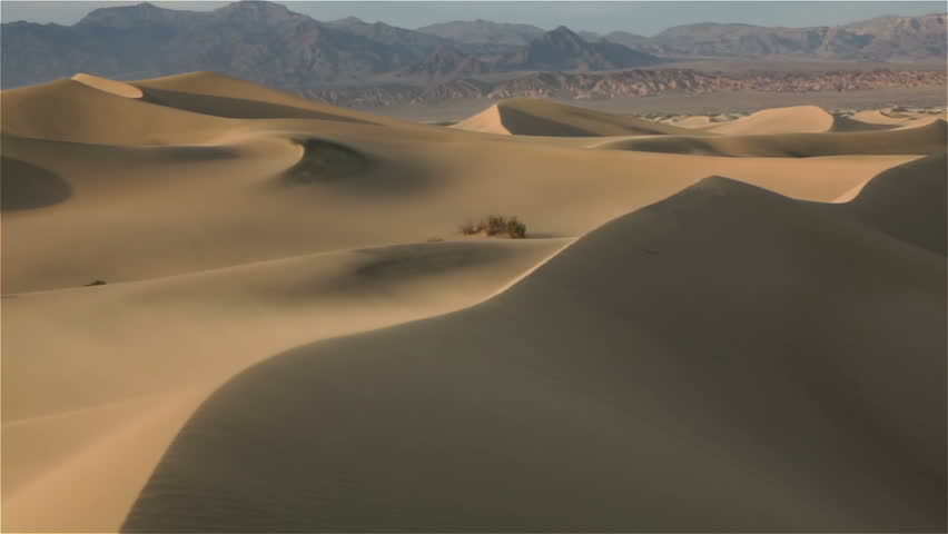 Mesquite Flat Sand Dunes, Death Valley National Park California USA , Wind blowing over sand dunes | Shutterstock HD Video #11679356