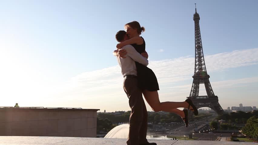 Happy young romantic couple having fun near Eiffel Tower in Paris, France | Shutterstock HD Video #11682146