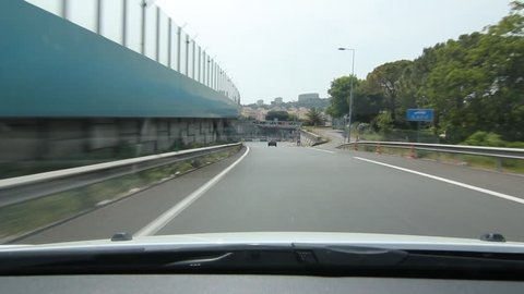 Highway exit in Nice, France. Approaching highway toll.