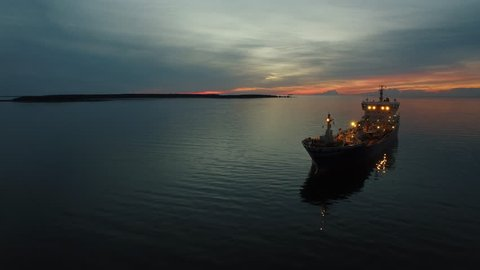 Aerial Shot of Tanker Ship Moving in Sea at Night.