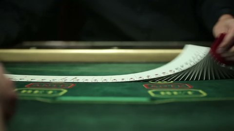 Casino: Dealer shuffles the poker cards. Slow motion
