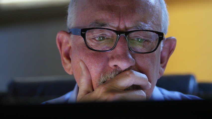 Older man talking back and upset at his computer | Shutterstock HD Video #11719154