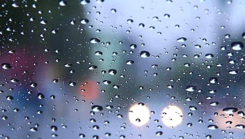 Stock Video Clip of Beautiful rain drops fall in slow motion. | Shutterstock