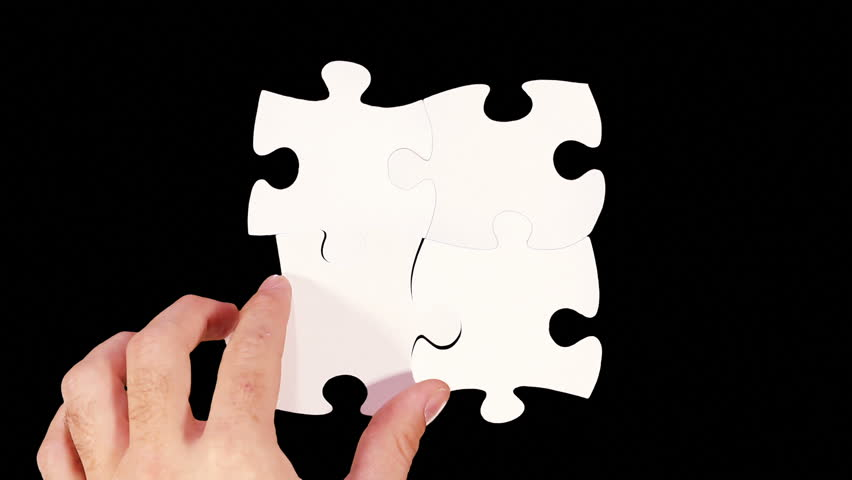 Hands solving a puzzle. Black background. 4 videos in one file. Female and male hands solving a blank puzzle. Alpha matte. More options in my portfolio.
