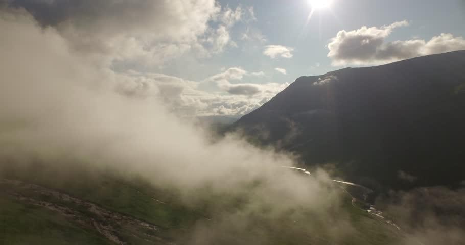 Stunning aerial shot of Glen Etive flying through low cloud revealing natures landscape in the Scottish highlands