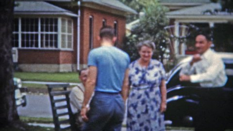 SPRINGFIELD, MISSOURI 1953: Brothers play fighting for parents attention, Dad joins in.