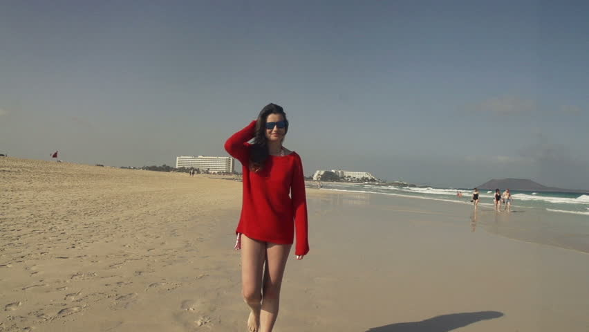 Happy Woman Flirting To Camera While Walking On Beach, Slow Motion ...