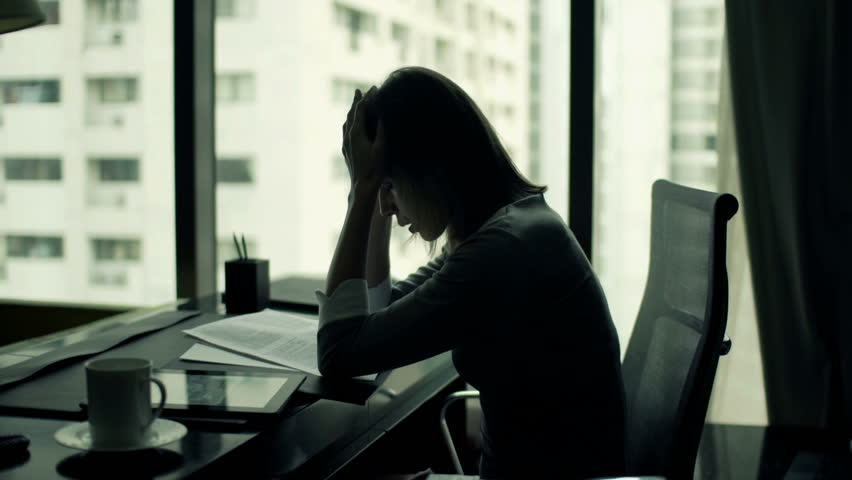 Sad, overwhelmed businesswoman working with documents and tablet computer by desk in office  | Shutterstock HD Video #11826956