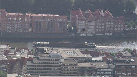 AERIAL Germany-Bremen 2007: Cargo boat travelling up river Weser, Bremen