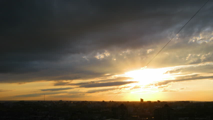 timelapse with beautiful sunset over town