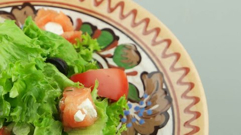 fresh salad with salmon on the decorative plate