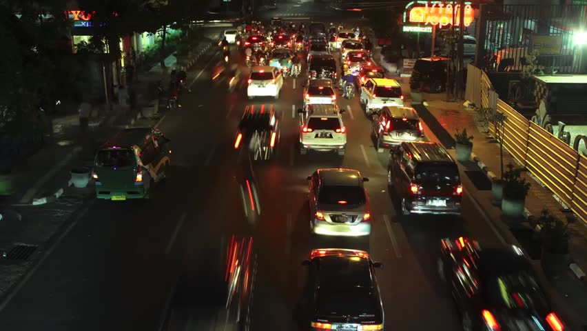 Bandung, West Java/Indonesia - September 20 2015: Time lapse busy street with car light in Bandung at night, city in West Java Indonesia