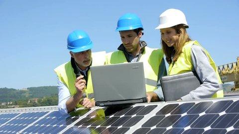 Engineers checking solar panels setup