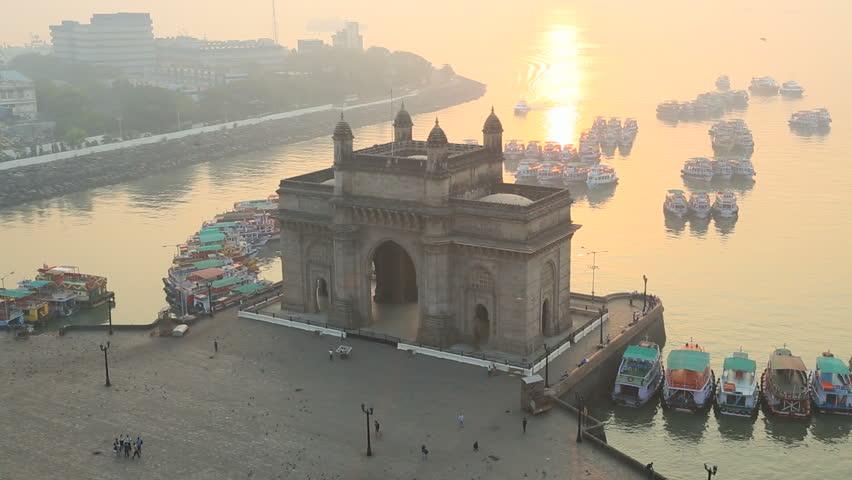 India - March 2015: Mumbai India Gate monument sunrise vessel building sea tourist city people palace travel harbour