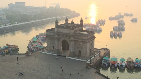 India - March 2015: Mumbai India Gate monument sunrise vessel building sea tourist city people palace travel harbour