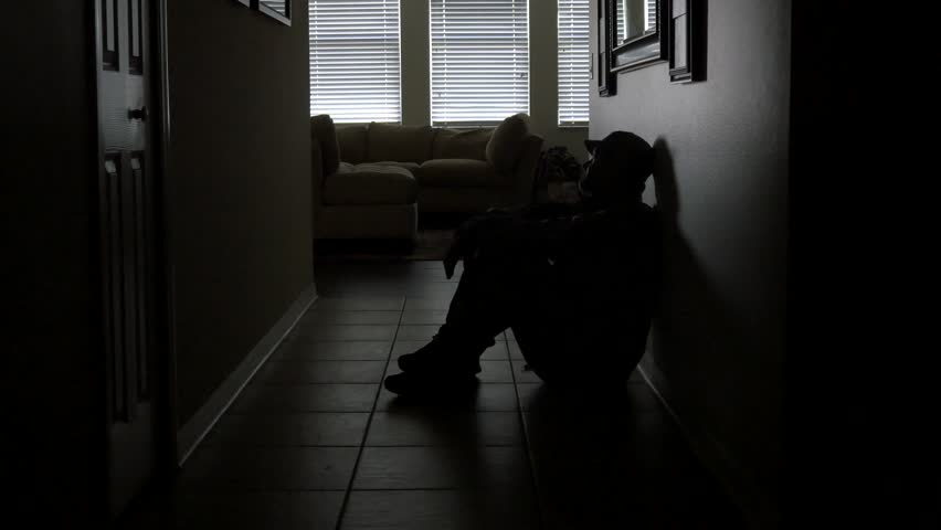 Lonely soldier silhouette sitting in dark hallway, WIDE, 4K | Shutterstock HD Video #11945786