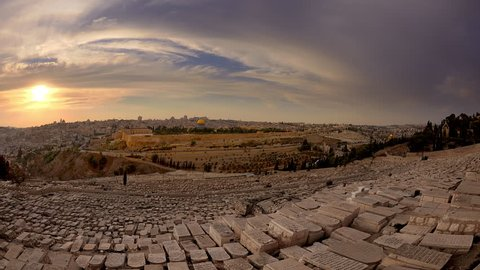 Israel - March, 2011: Time-lapse from the Mount of Olives overlooking the cemetery towards the Dome of the Rock at sunset.