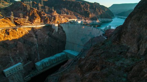 Time-lapse aerial shot of Hoover Dam with lens flare. This was taken at sunrise.