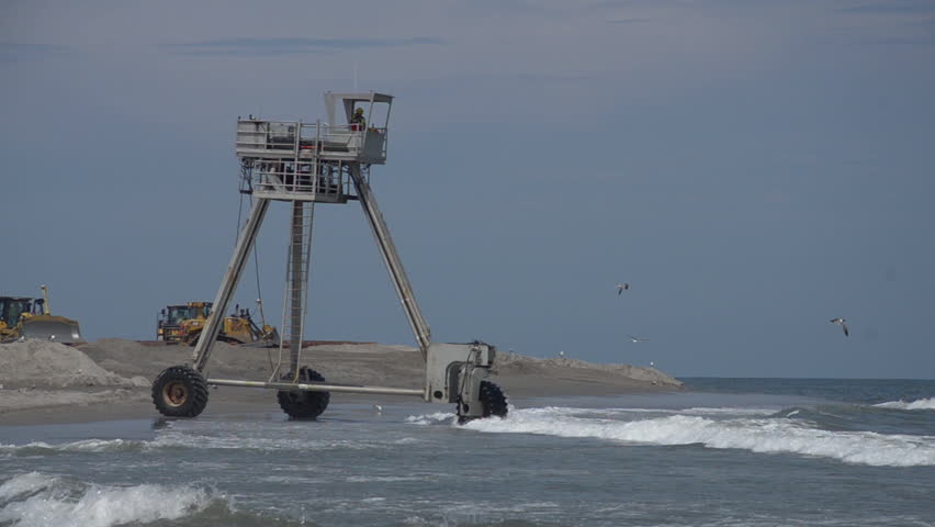 """LONG BEACH ISLAND, NEW JERSEY/USA - JULY 13, 2015: Three wheeled vehicle drives down beach. Vehicle is called a CRAB or """"Coastal Research Amphibious Buggy."""" 1080p HD. 