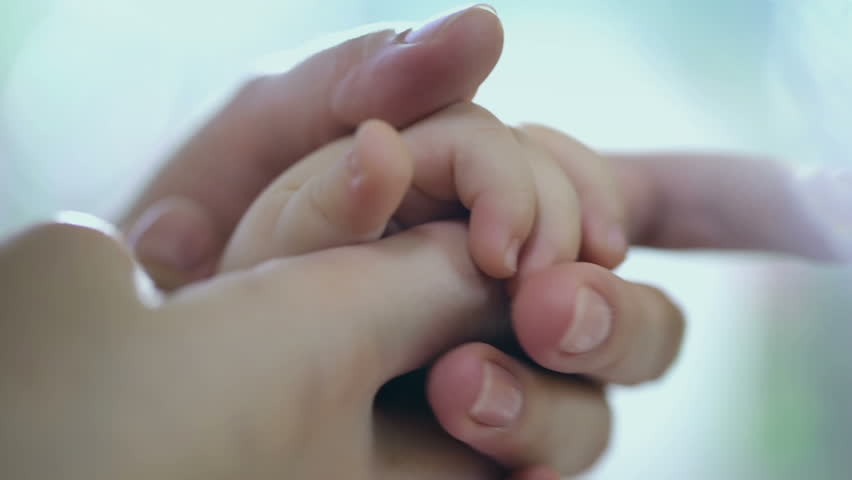Caring mother with baby, Concept of love and family. hands of mother and baby closeup, Hand in hand. Mother care. Playing with baby at home. Slow Motion.  FEW SHOTS ! #12004886