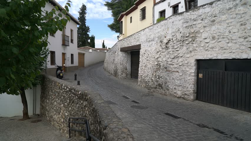 granada andalusia spain sept 29 2015 single motorcycle driving through a - Single Wall Castle 2015