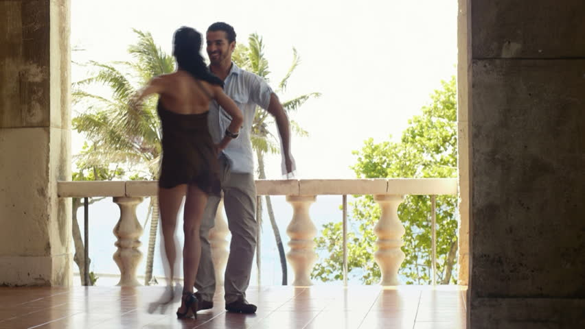 young hispanic couple dancing latin american dance outdoors